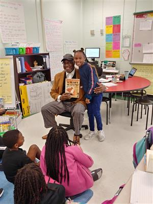 Bishop Mack reading to 3rd grade