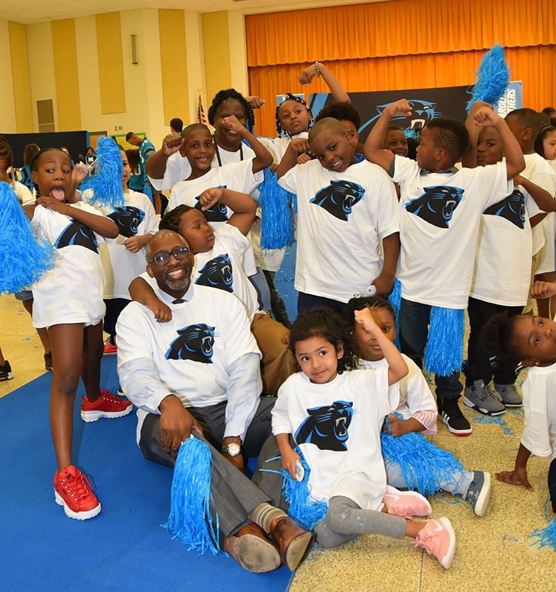 Dr. Witherspoon at Panthers event with kids