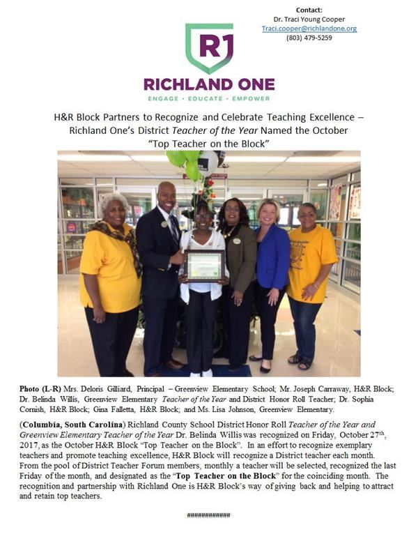 Picture of Dr. Willis receiving an award from H&R block