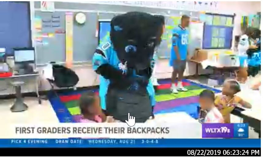 Panthers Organization Donates Backpacks