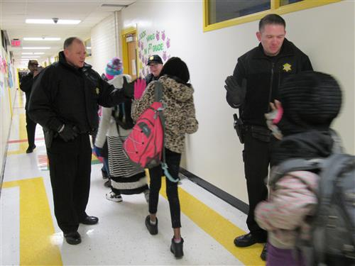 Deputies High Five Students