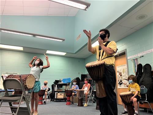 Johannes Linnan conducts music class at Brockman Elementary School